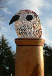 Bird head in glass